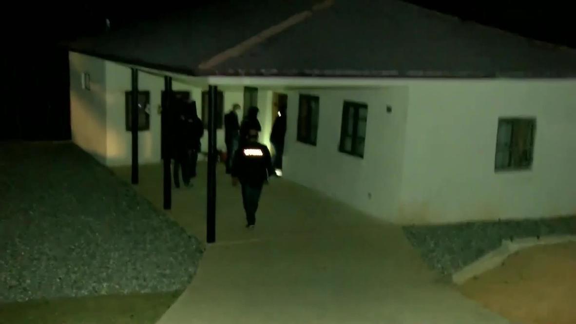 جورجيا: القوات الخاصة تداهم منزل لص مسلح احتجز 43 رهينة في مصرف