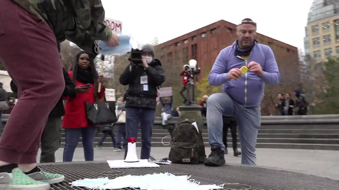 USA: Anti-lockdown protesters burn masks at New York City demo
