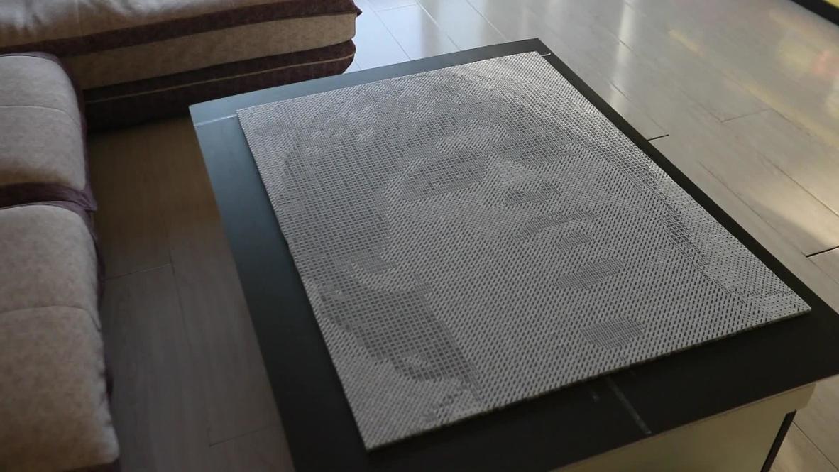 Chinese artist creates impressive dice portrait of late football legend Maradona