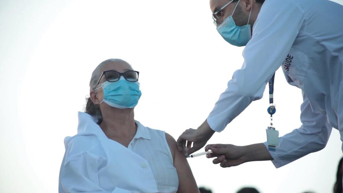 Brasil: Residentes de Río de Janeiro reciben las primeras dosis de vacuna contra el covid frente al Cristo Redentor