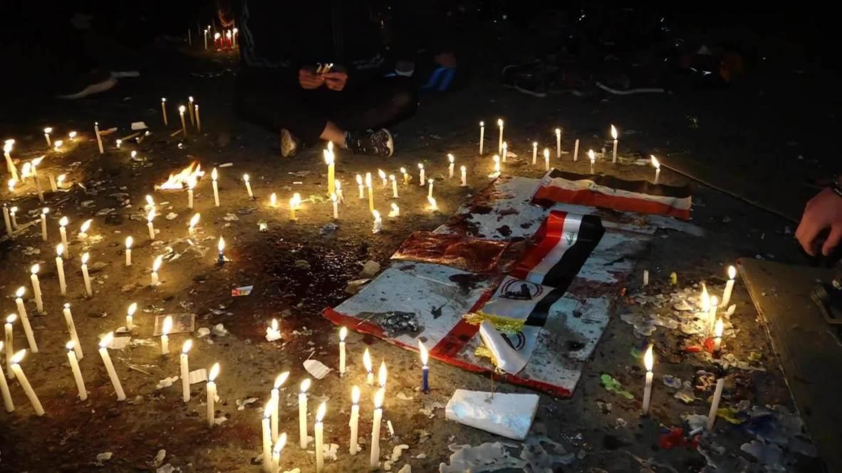 Irak: Residentes de Bagdad encienden velas por las víctimas del doble atentado suicida